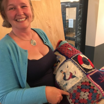 Emma Pusill with Lynne's Quilt